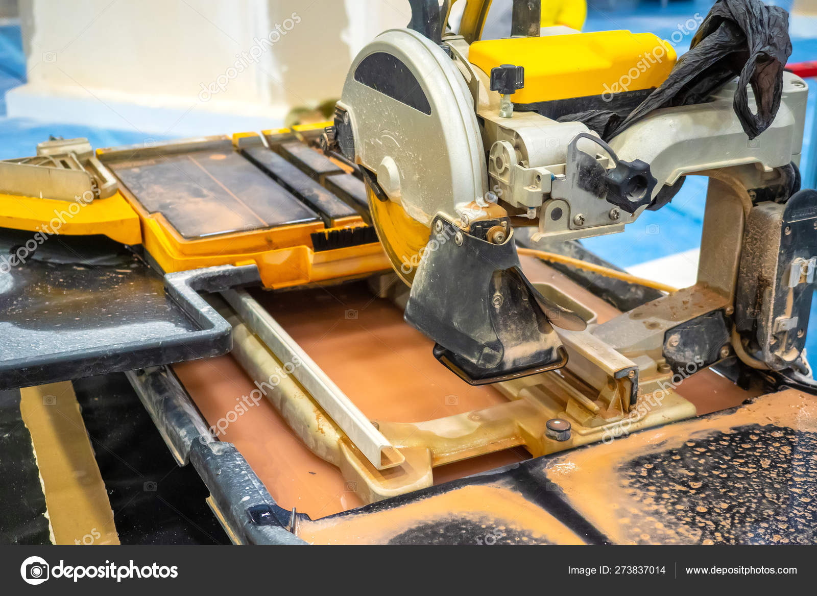 cutting tile a circular saw a builder performs a tile cut finishing work circular saw with water supply work at the machine stock photo image by c grinphoto 273837014