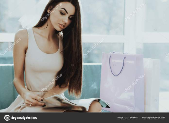 smiling girl reading glossy magazine hen party pre wedding care