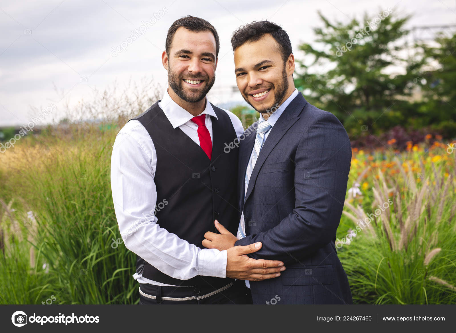 A Handsome Gay Male Couple In The Park On Their Wedding Day Stock Image