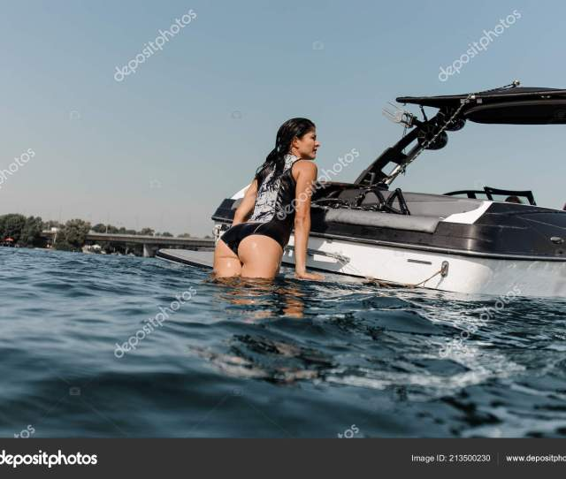 Attractive Girl Nice Ass Black White Swimsuit Climbing Motorboat Background Stock Photo