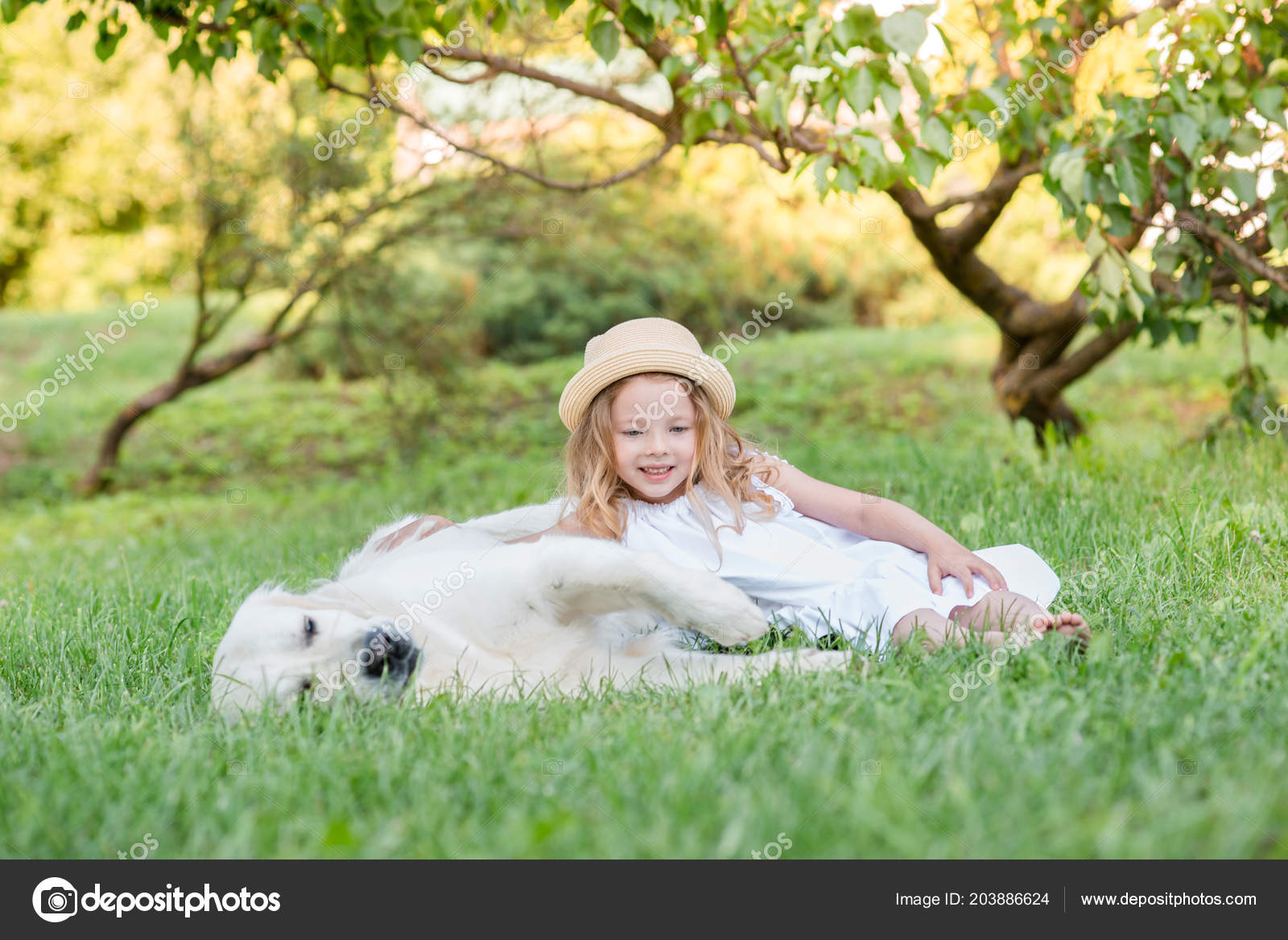 Little Girl With A Big White Dog In The Park A Beautiful 5 Year Old Girl In White Dress Hugs Her Favorite Dog During A Summer Walk Photo By