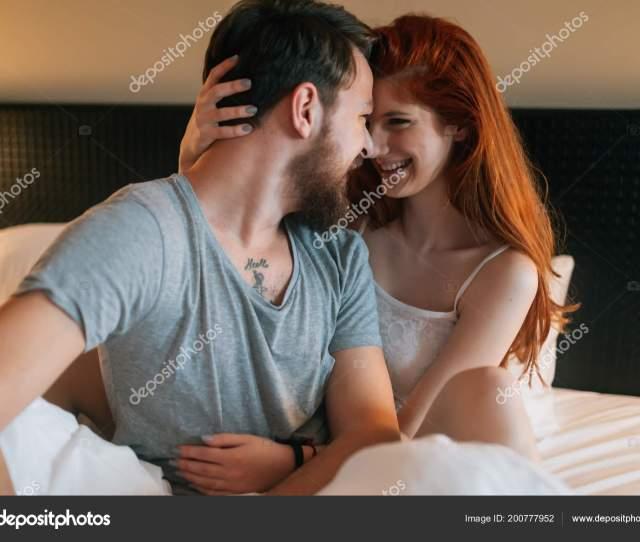 Passionate Beautiful Couple Bedroom Enjoying Foreplay Stock Photo