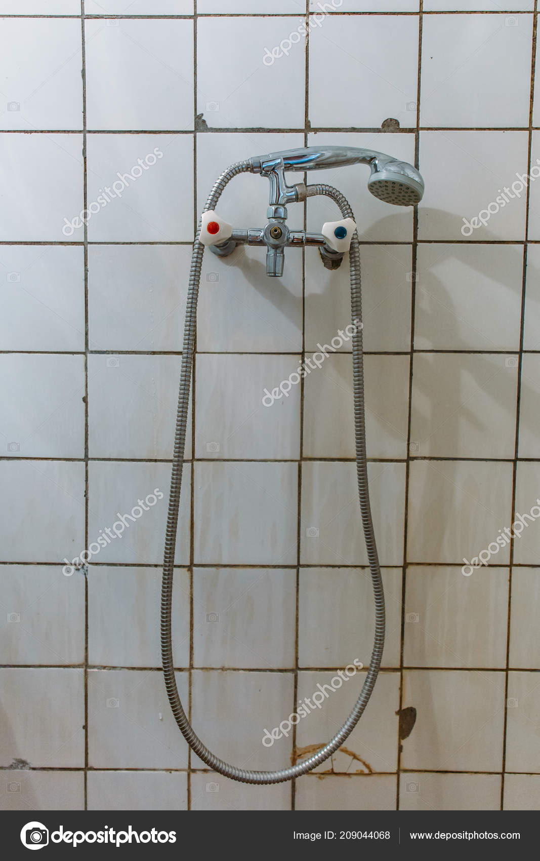 old steel shower faucet at white vintage tile background stock photo image by c dedmityay 209044068