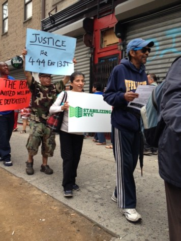 Tenants of 444 East 13th Street demonstrate before announcing a new harassment suit.