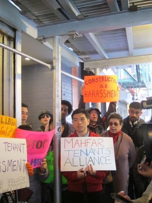 Tenants of buildings owned by Mahfar demonstrate against toxic lead levels in their buildings