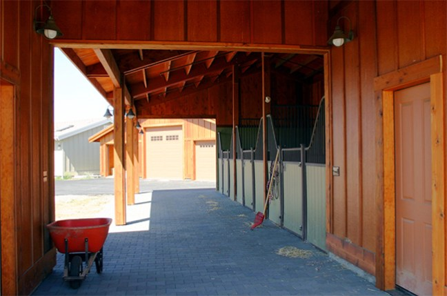 Open aisle in front of the three stall barn