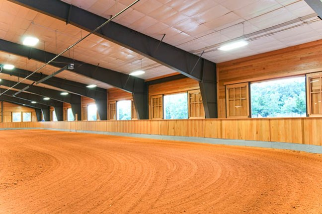 Covered riding arena with large windows