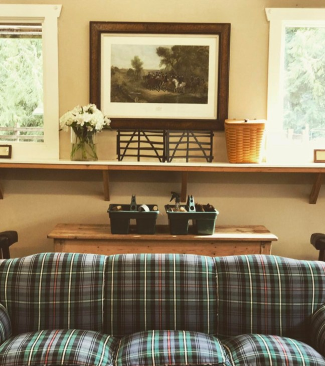 a plaid couch in the tack room