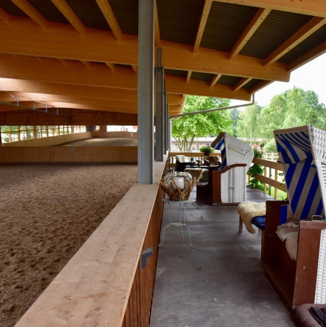 indoor riding arena with a summer view