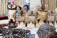These owl figurines are hand carved my the indigenous women you see in the background
