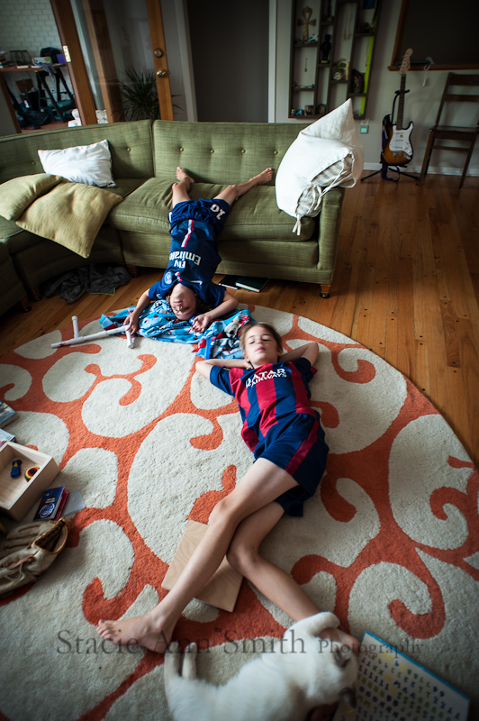 color photograph with boys watching tv on the couch