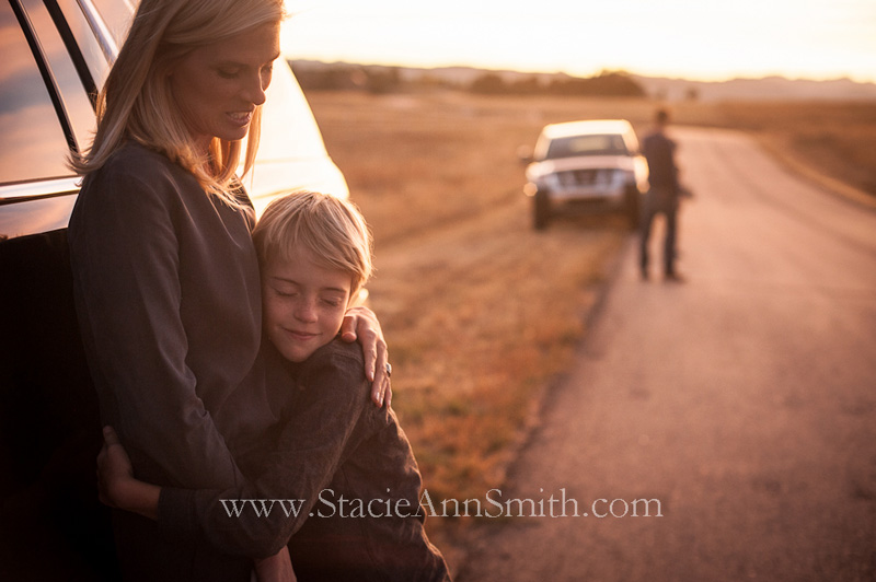 Photograph of a hug from mom beside the road.