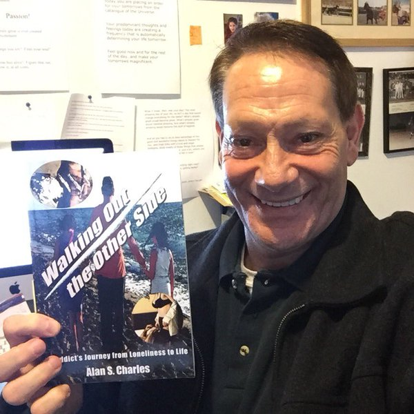 alan s charles with his book