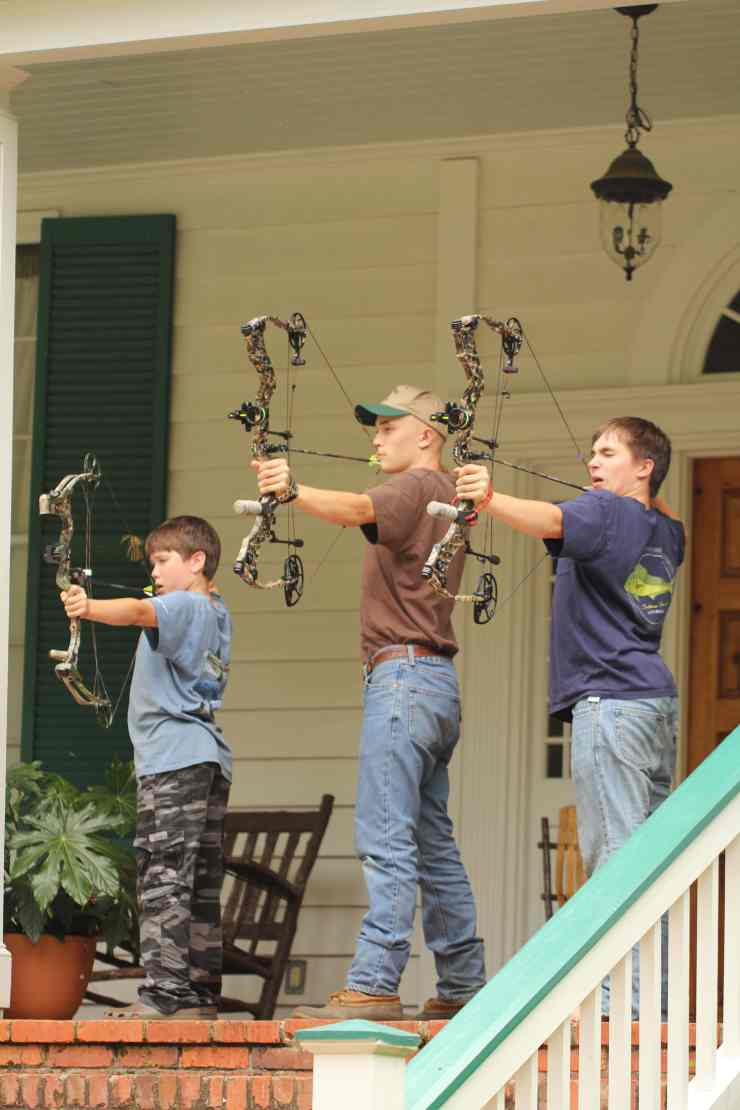 Harris Boys Practicing Bow Shooting
