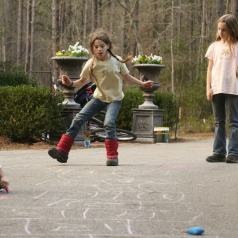 Children playing hopscotch to illustrate the point about getting exercise while being a young mom