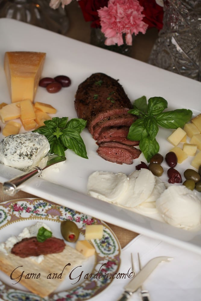 I love starting the night with a duck, cheese, and olive sampler that is bursting with flavor and simple elegance.