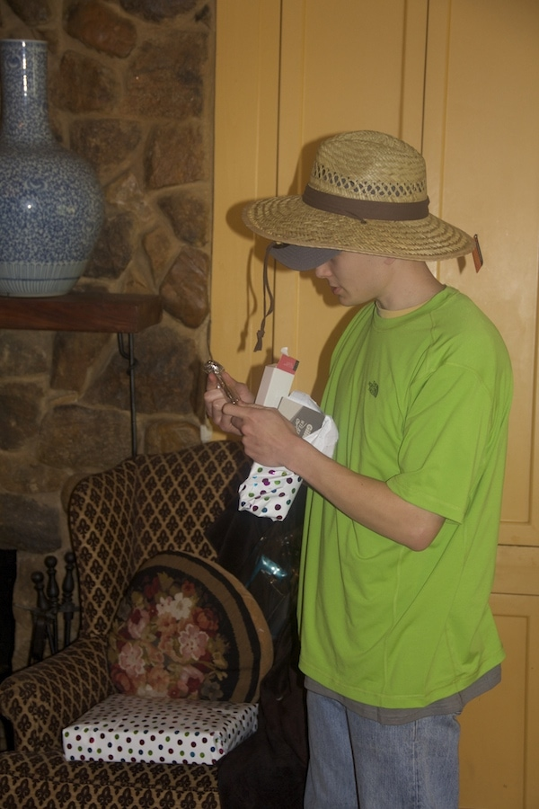 Hunter added yet another shirt and if you look closely a hat is under the farm hat.