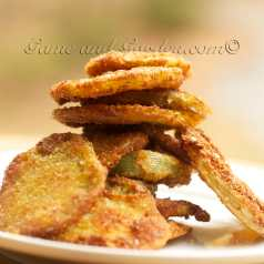"""Fried Green Tomatoes Ingredients 4 large firm green tomatoes 1 cup all-purpose flour 1 teaspoon salt, more for sprinkling 1/2 teaspoon pepper 2 eggs 1 Tablespoon water 1 cup bread crumbs 1 cup Olive Oil for frying 4 Tablespoons butter Slice the tomatoes 1/4 inch thick. On a large plate, mix flour, salt, and pepper. On a second plate beat eggs and water together. Place bread crumbs on a third plate. Coat tomato slices into seasoned flour, then egg mixture, then bread crumbs. In a hot sauté pan, mix butter and oil. When sizzling, place coated slices in pan for about 2 to 3 minutes per side or until tomatoes are tender. Cook in batches and add more oil if needed. Transfer to a platter, sprinkle with extra salt and serve warm. For a healthier version of this recipe, check out my Healthier Crunchier """"Baked"""" Fried Green Tomato recipe."""