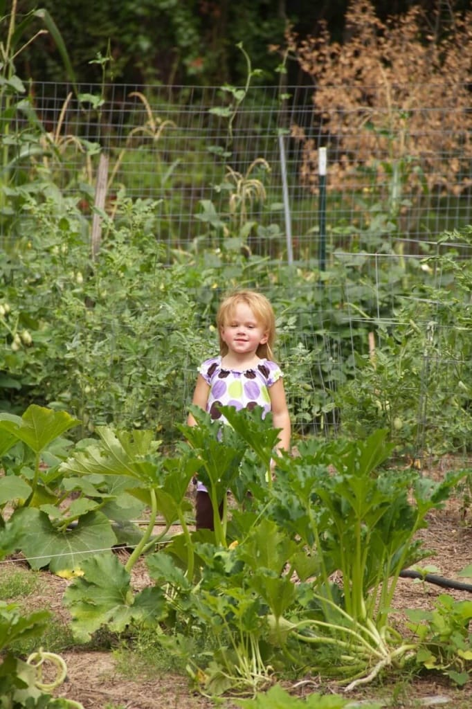 Stacy's daughter posing in the garden