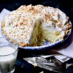 Coconut pie topped with whipped cream