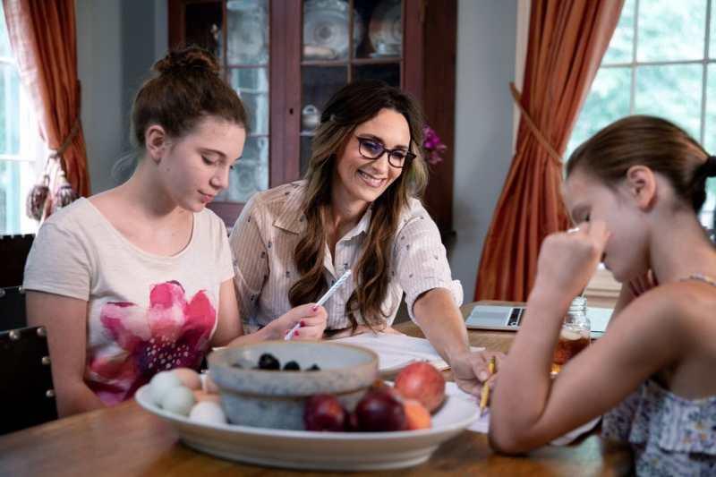 Stacy Lyn Harris homeschooling her children