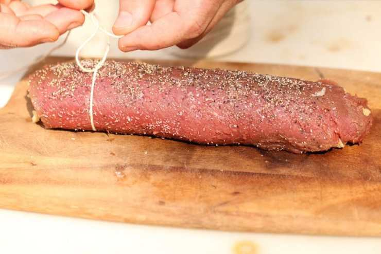Picture of venison tenderloin, demonstrating the trussing technique to stuff venison loins, photo by Stacy Lyn Harris