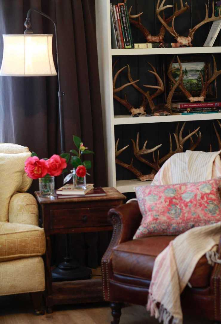 A shot of a living room at Stacy Lyn Harris's Purple Door house showing how she uses color in her accent pieces and furniture to make a cohesive interior design