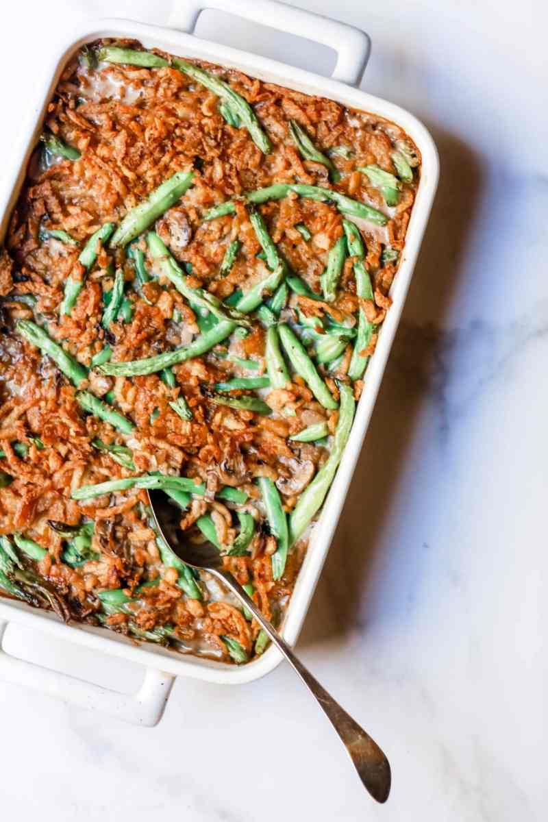 """Photo of a pan or tray of homemade green bean casserole, from Stacy Lyn Harris's recipe for """"Classic Homemade Green Bean Casserole"""" Christmas 2019"""