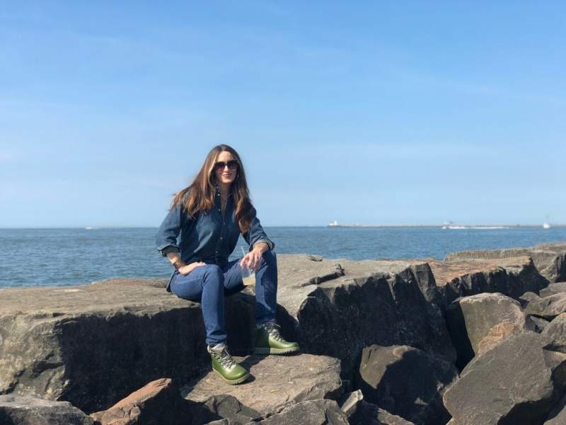 Stacy Lyn Harris posing for a photo on Lake Superior during her visit to the Lehman's facility in Ohio for the Country Living Workshop