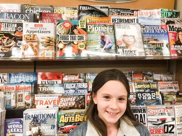Stacy Lyn Harris and daughter seeing a copy of New Pioneer Magazine on shelves at the bookstore