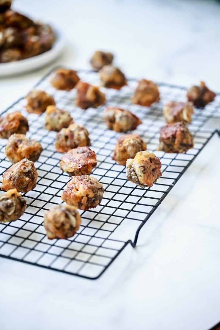 Sausage Balls with Cheese on Cooling Rack on White Marble