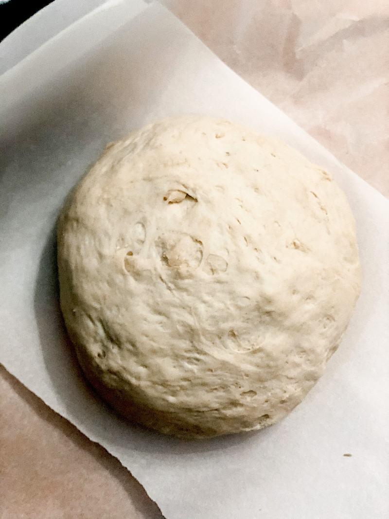 Dough that has risen a second time on a piece of parchment paper