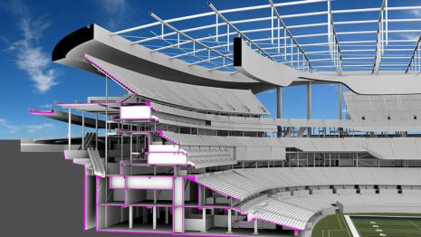 Cross-section perspective highlighting the below grade playing field (Photo: HKS Architects)