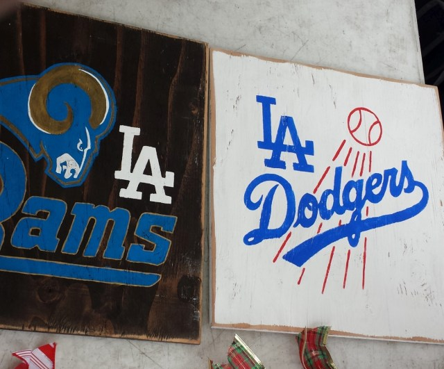 A couple of hand-painted signs featuring the logos of a couple of our local teams