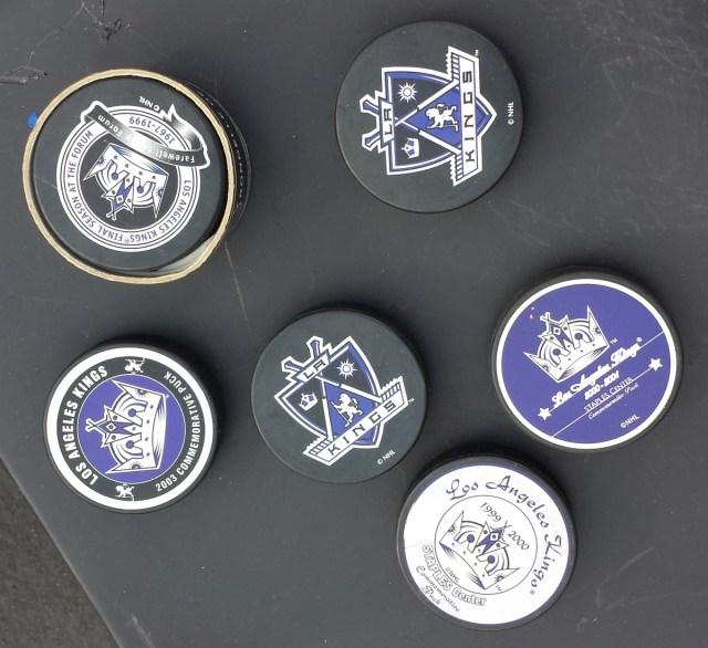 Assorted LA Kings hockey pucks