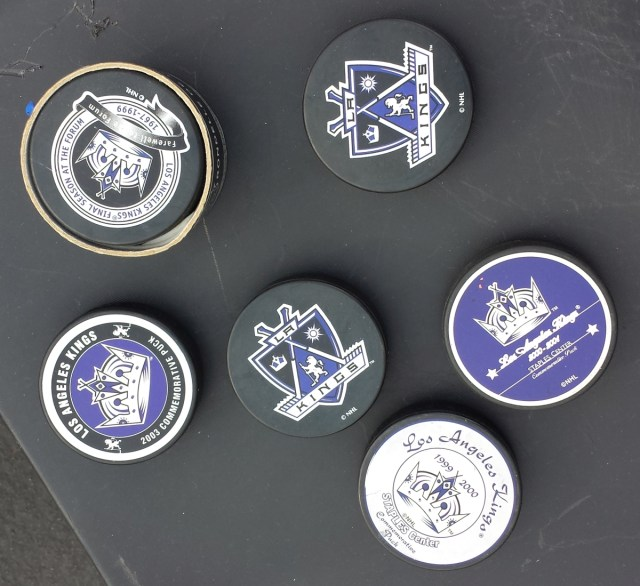 Assorted LA Kings hockey pucks
