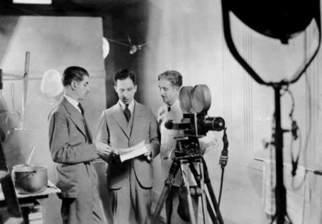 Another photo taken on the same set and the same day. Left to right: Lew Parry, Leon Shelly, and cameraman Mel Parry (Lew's brother). [BC Archives I-61631; donated by Lew Parry]