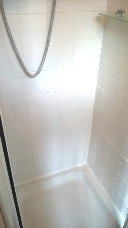 Grout Colouring Ceramic shower tiled cubicle in stafford after