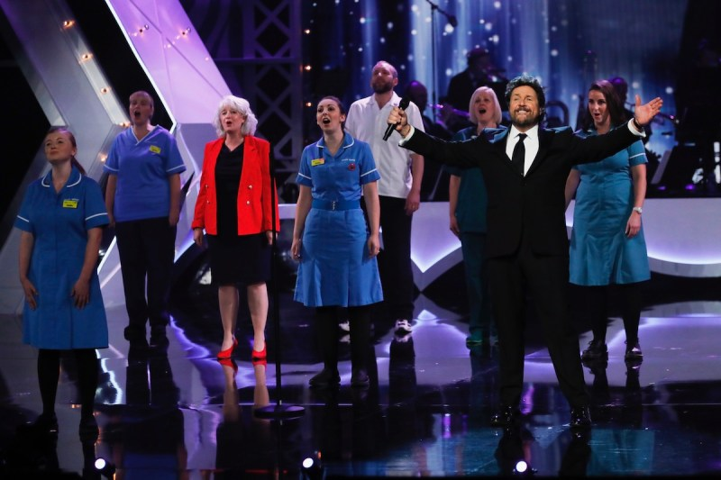 Captain Sir Thomas Moore joins forces from his home for an exclusive performance with legendary singer and entertainer Michael Ball on stage at the Opera House with the NHS choir. Picture: ITV/Matt Frost