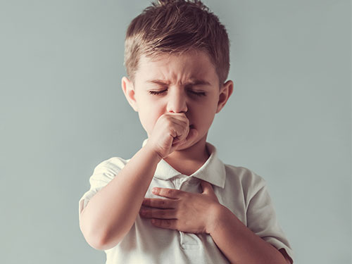 young boy coughing