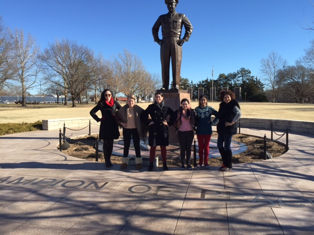[Photo courtesy of Adriana Popa | European Institute fellows with Ike's statue on the grounds of the archives]
