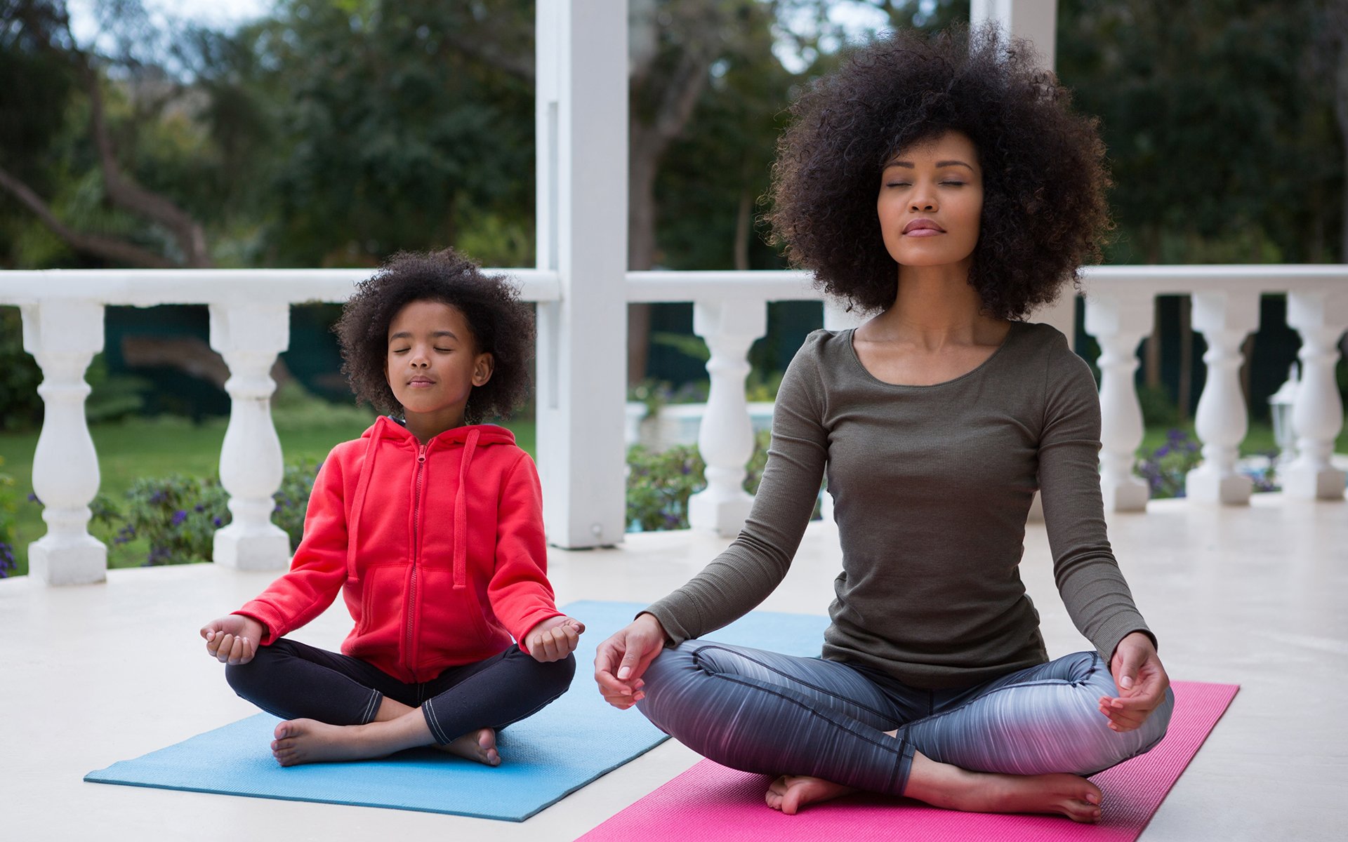 How You Can Help Others by Practicing Mindfulness- Mother and daughter meditating together on the porch