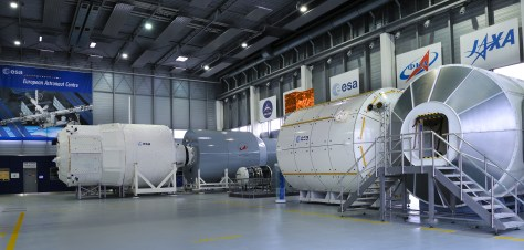 A photograph taken inside the European Astronaut Centre in Cologne, Germany, showing replicas of the ISS living units.
