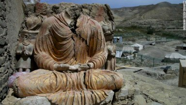 A photograph showing the headless body of a 2,600 year old statue at the Buddhist site of Mes Aynak, near one of Afghanistan mines.