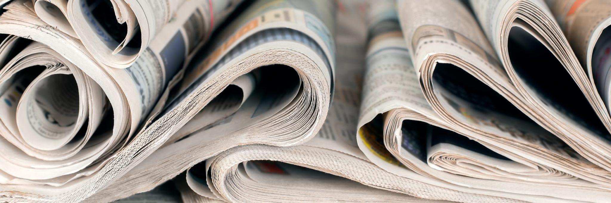 Close-up panoramic of newspapers
