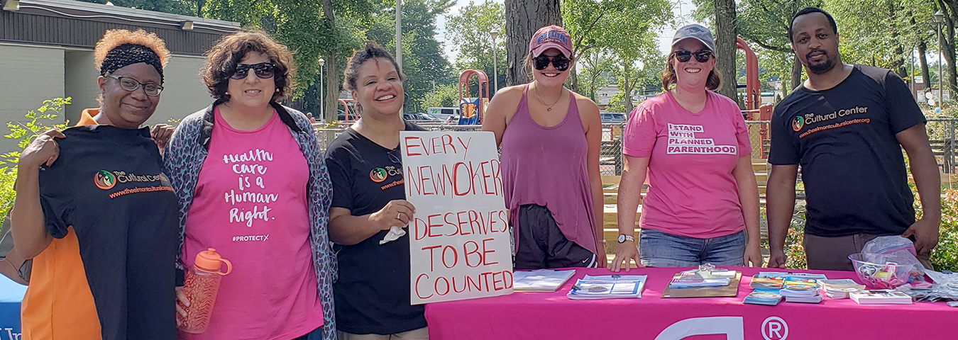Members organized by the Cultural Center of Elmont, Long Island, get out the count in early 2020. They have a sign that says,