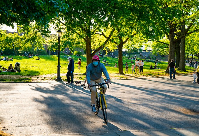 Man riding his bike in the park.