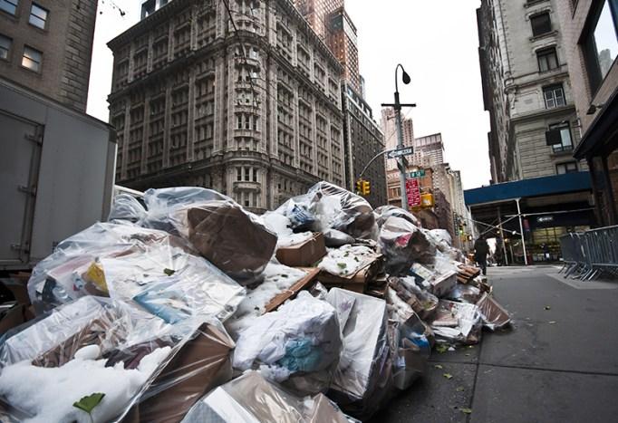 A pile of trash on the sidewalk.