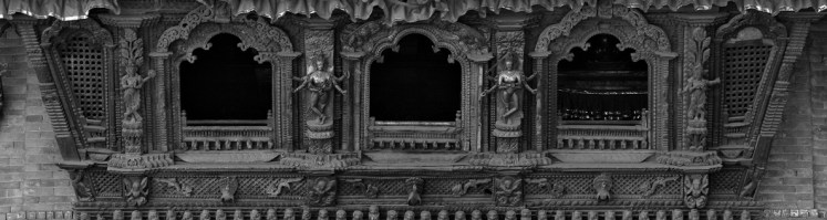 beautiful hand-carved artistic window famous in the tradtional houses of Nepal in Kathmandu
