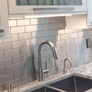 Stainless Steel Tile backsplash in a subway pattern